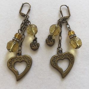 Antiqued brass and gold-colored crystal ea…